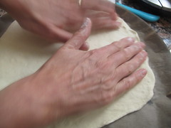 Stretching out pizza dough