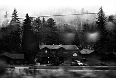 sanctuary (futtoom.) Tags: winter blackandwhite snow monochrome inn lodge snowfall pinetrees takenthroughawindow