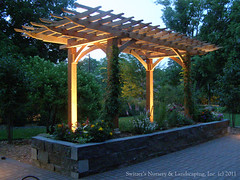 Clay Paver Dinning Patio with Natural Stone Raised Planter and Cedar Pergola ~ Up-Lighting on Pergola (Switzer's Nursery & Landscaping) Tags: minnesota stone landscape design natural landscaping stonework glenn cedar handcrafted stonewall northfield pergola handset naturalstone waller switzers arbour switzer drystack landscapedesign designbuild hardscape hardscaping customdesigned glennswitzer switzersnursery landscapedesigns pergoladesigns theartoflandscapedesign switzersnurserylandscaping arbourdesigns artoflandscapedesign