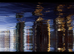 Urban Shred (ecstaticist) Tags: city blue light sky urban canada reflection water skyline vancouver skyscraper photoshop harbor pier bc waterfront flood wind cyan wave wharf tall effect coalharbour condominium striation shred phtomatix