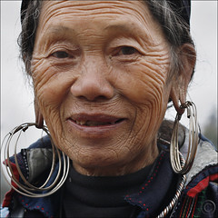 The beauty of the landscape -- on her face (NaPix -- (Time out)) Tags: new old portrait woman face happy buffalo year ox vietnam celebration explore lunar lanscape journalism sapa hmong opop  napix theyearofthebufalloox jawnshanochagoodheartnewyearinhmong thebeautyofthelandscapeonherface cccunanimous