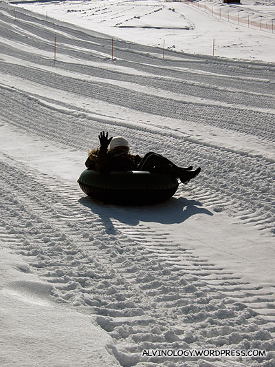 Rachel sledding down