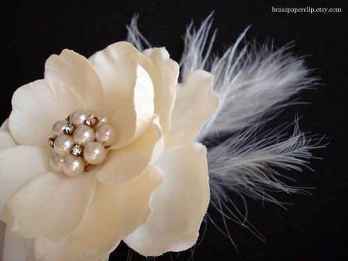 Ivory Magnolia with vintage pearl and rhinestone earring as centerpiece