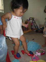Aki trying on princess slippers