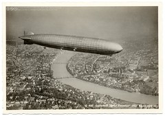 The Graf Zeppelin over Basel (1930) (postaletrice) Tags: old city ro vintage river germany geotagged deutschland schweiz switzerland flying view shot suisse suiza antique swiss aircraft postcard flight zeppelin dirigeable ciudad aerial basel antigua german blimp vista alemania airship postal vol vue ville postale birdseye carte dirigible airmail 1930 ancienne fleuve vuelo postkarte lighterthanair volando tarjeta luftpost cpa ansichtskarte basilea volant luftschiff zepeln aeronave allemange grafzeppelin aronef lz127 correoareo zeppelinpost
