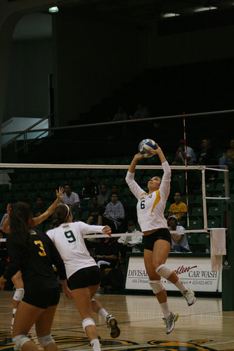 Junior Alaina Sully sets the ball for Hadley Simmons.  Melissa Stihl/Foghorn