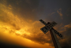 Sunset Sign (Wavy1) Tags: railroad sunset colorado crossing hill pueblo tracks beacon speedway