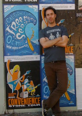 my husband hugh in front of his surfer poster!