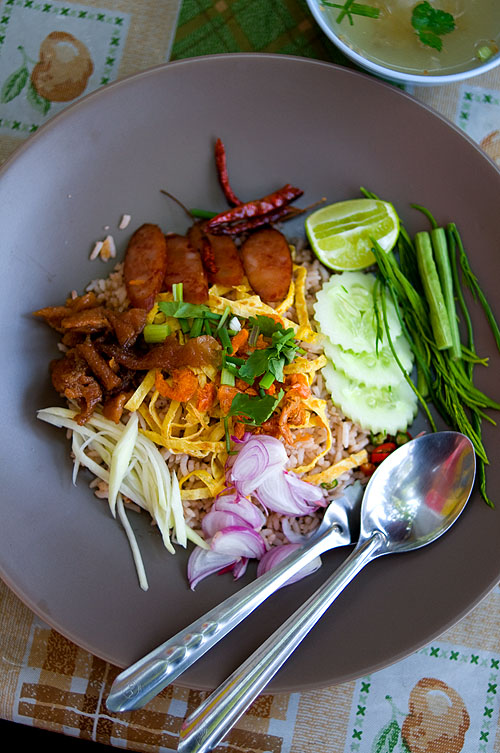 A dish of khao khluk kapi, rice cooked in shrimp paste with a variety of toppings,  at a street stall in Bangkok's Banglamphu district
