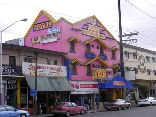 A motel on Calle Madero.  Pink with yellow and blue trim?  Sure.