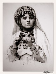 Portrait of an Algerian Woman III. (Algeria888 ( G.Zoua )) Tags: africa portrait woman hair algeria dress traditional brooch earring wear ring jewelery ornate smock customs rahi lollll tebroum felgaro zaama09
