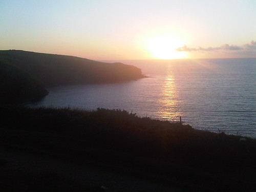Sunset over the cliffs at Port Isaac