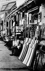 Portrait 14 (Sai Abishek) Tags: road street portrait india white black shop side carpets pondicherry keeper