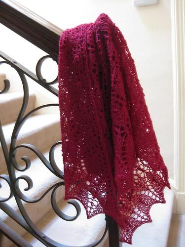 Scarlet lace shawl in shetland