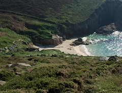 Nanjizal (farwest56) Tags: uk family sea england people sun holiday colour green beach sand rocks cornwall shoreline footprints valley remote greenfield seashore isolated sunbathe gorse coastpath outoftheway a350
