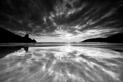 Black & Wet (PhotoToasty) Tags: bw seascape beach clouds sand ominous dramatic guernsey petitport monochrone