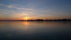 P1050244 (Remko van Dokkum) Tags: sunset zonsondergang natuur zon ijs schaatsen monnickendam schaats ondergang ondergaande natuurijs gouwzee
