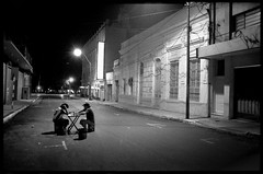 3am domino players (Rene Collin) Tags: street bw white playing black game film strange night america photography south rene documentary surreal surrealist asuncion paraguay domino collin renecollin