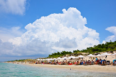 Sani Beach (Faddoush) Tags: sea summer beach clouds nikon hellas explore greece frontpage sani halkidiki faddoush