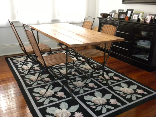 Trestle Table and 4 Wicker Chairs from Pottery Barn
