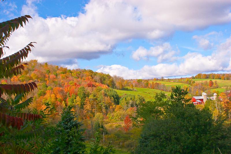 Autumn farm and hills