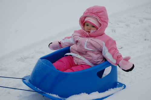 Ardyn goes sledding around the yard with Grandma Deb