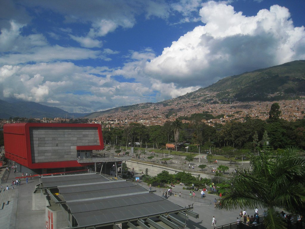 Medellin's biggest aquarium (foreground) as seen from the nearby metro platform.