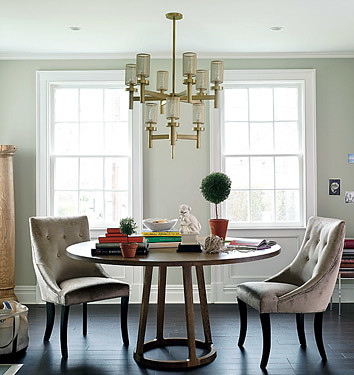 Elegant dining room: Circular table + upholstered chairs, from Domino