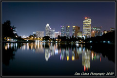 City Business District taken Kallang Riverside Park (Sam Calma) Tags: park reflection riverside nightshots kallang blueribbonwinner supershot 5photosaday colourartaward