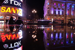 intervals (maybemaq) Tags: street uk blue light england urban reflection london water rain night dark couple colours purple traffic britain tube piccadilly piccadillycircus transparency sanyo tubestation signboard aftertherain breathtaking shaftesburyavenue rendezvous nightwalk tdk waterreflection colorphotoaward