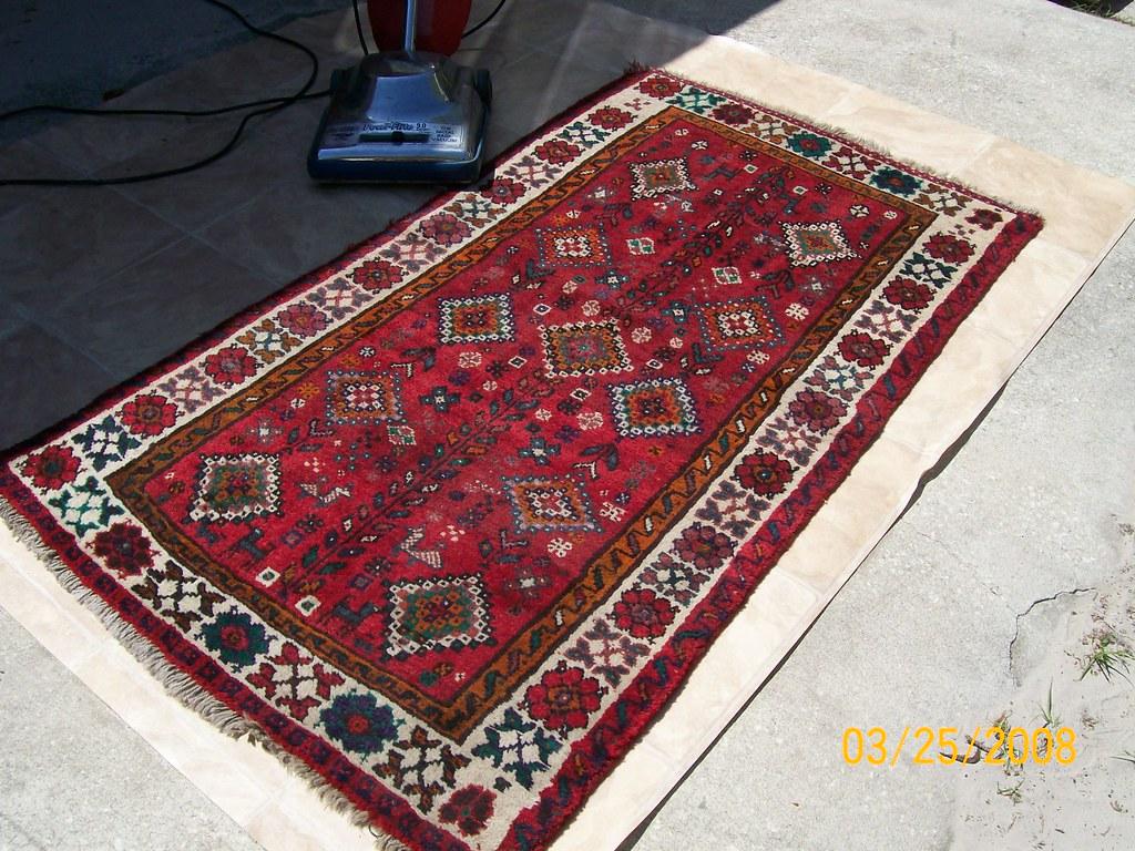area rug before vacuum