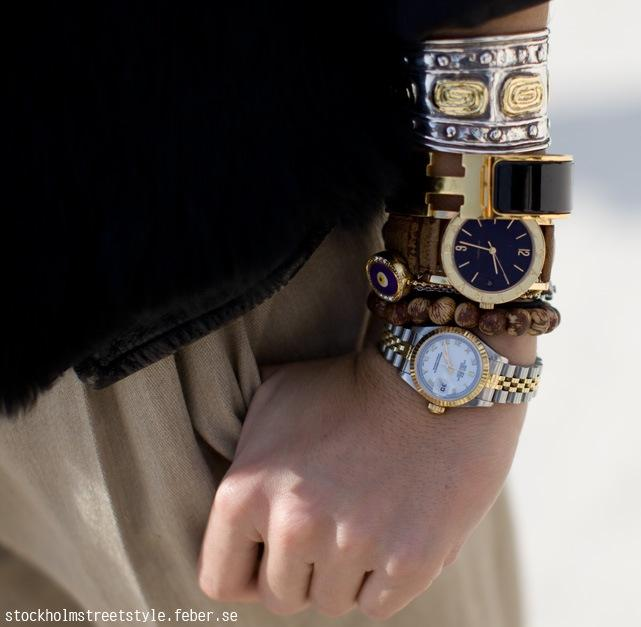 Multiple watches worn as jewelry 2