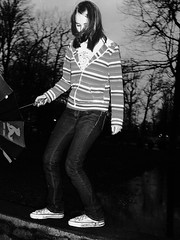 Dancing Shoes (photograph-e) Tags: park trees blackandwhite reflection feet water girl rain night umbrella dark hair outdoors stand dance shoes stream mud stripes nail spiderman polish move sneakers converse michaeljackson keely bent knees grip 2008 chucks hold chucktaylors allstars traveler sidetoside dc8600