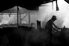 the charcoal maker (jobarracuda) Tags: lumix smoke philippines manila worker pinoy fz50 usok tondo panasoniclumixdmcfz50 jobarracuda manggagawa trabahador jobar jojopensica ulingan photokalye charcoalmaker