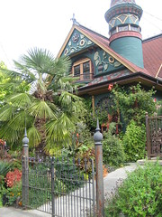 Nob Hill House (AGA~mum) Tags: palmtree turret carvings paintedlady victorianhome ornategates latinphrase queenannehillseattle nobhillinseattle quoampliuseoamplius