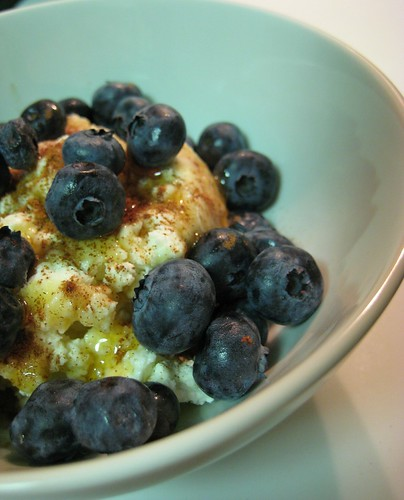 homemade fresh ricotta with cinnamon, honey and blueberries