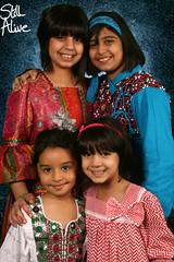 girls (Still Alive ..) Tags: lighting girls portrait smile kids canon studio children together kuwait q8 stillalive 400d moiq8