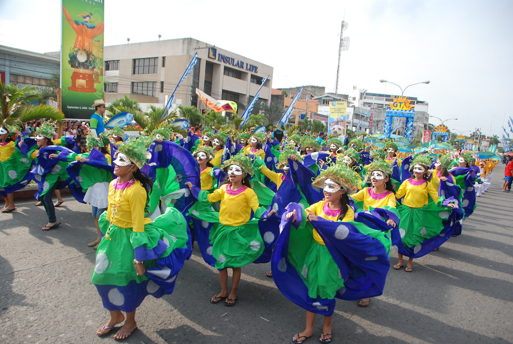 Mardi Gras Dancers along the stretch of Pioneer Avenue