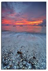 Pebbles (Nora Carol) Tags: longexposure beach waves pebbles sabah slowmotion malaysianphotographer northborneo nikond90 noracarol kotakinabalusunset sabahanphotographer landscapephotographerfromsabah womanlandscapephotographer womaninphotography