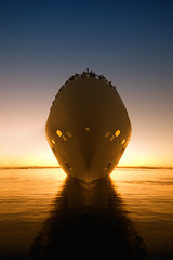 Bon Voyage (Lee Sie) Tags: ocean california cruise blue sunset sea orange reflection water bay harbor boat marine ship glow sandiego alien egg ufo passengers mast liner symetryornotsymetry