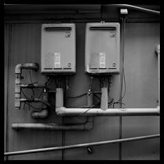 Gas Works (gullevek) Tags: blackandwhite 6x6 japan wall geotagged iso100 tokyo fuji pipes gas 日本 東京 モノクロ 中央区 有楽町 fujineopanacros100 epsongtx900 bronicaectl zenzanonmc80mmf24 geo:lat=35672607 geo:lon=139760787