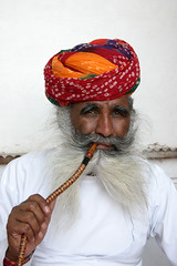 Man in Jodhpur (sensaos) Tags: old portrait people india man face beard asian person asia retrato indian traditional pipe culture traditions smoking moustache clothes persons turban portret ritratto cultural rajasthan портрет jodhpur cultuur headwear mensen azië 肖像画 초상화 画象