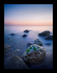 lavender-ocean (biancavanderwerf) Tags: blue sunset sea seaweed beach movement rocks stones lavender greece bianca purper