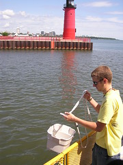 Tyler pulls up a water sample near the junction of Milwaukee's rivers. ~photo Jennifer Yauck