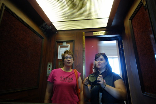 Inside the elevator being serious