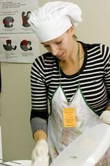 volunteer wiping trays