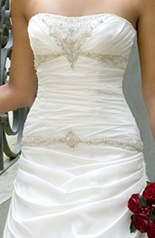Embroidered strapless gown and crystal.