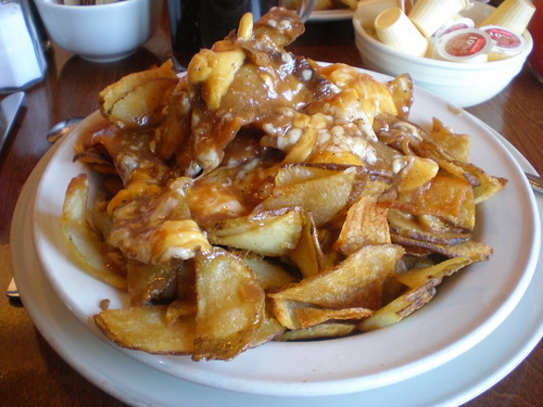 The Rebel Poutine: kettle fries covered in curds, smoked mozzarella, and gravy