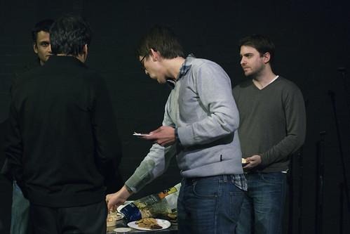 Panel attendees gather around snacks
