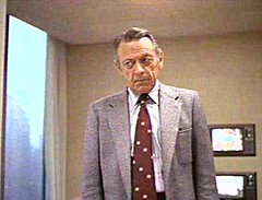 William Holden as network suit Max Schumacher